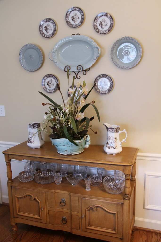 Plate display over antique dining room sideboard