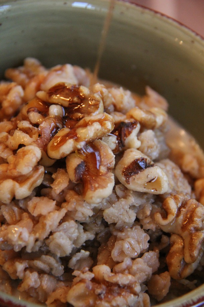 pouring syrup on spiced cider oatmeal