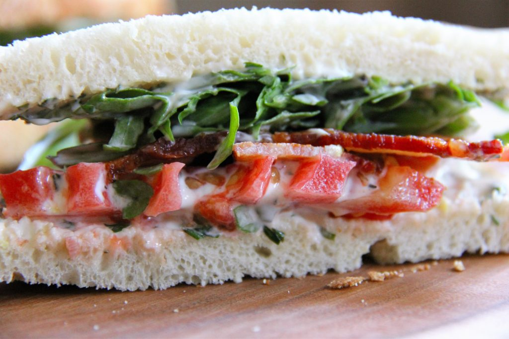 fancy BLT sandwich cut in half
