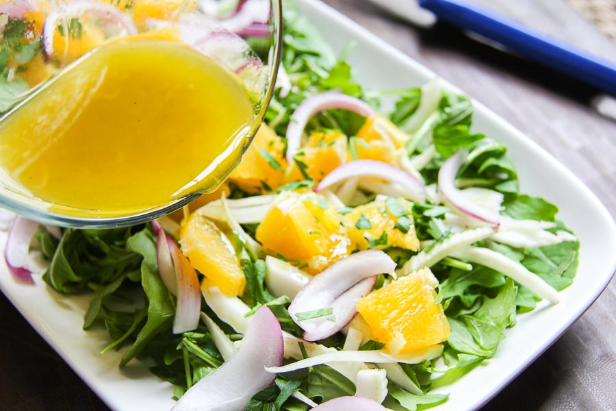 dressing arugula fennel salad with citrus