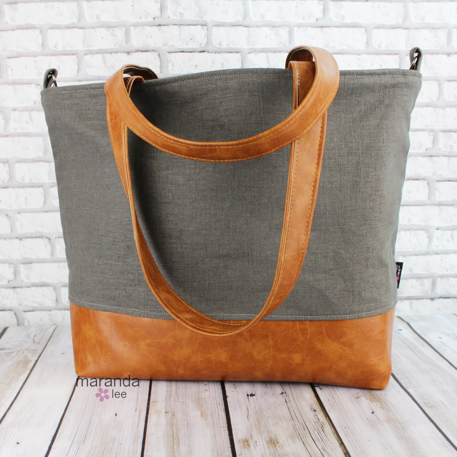 grey canvas and leather bag travel gear
